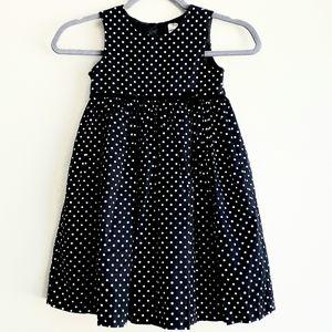 Girl's black and white polka dot dress